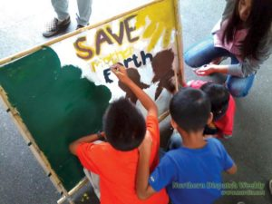 A small call. Little hands painting their advocacy to save the Earth and make a difference. Photo by Carmela Balcita